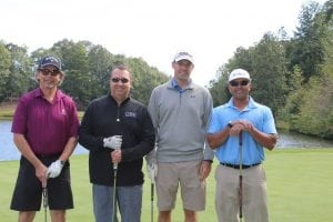 Tournament participants Robb McKerrow, Greg Swinks, Larry Borne, and Hettish Patel